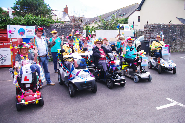 Group of elderly Watchet Locals entering the Carnival Parade on their mobility scooters