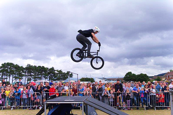Man in mid-air making a jump on his BMX in Watchet
