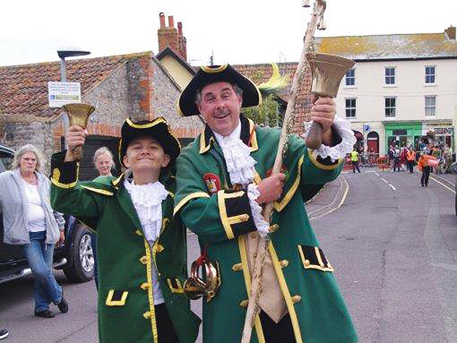 Watchet Town Criers ringing their bells