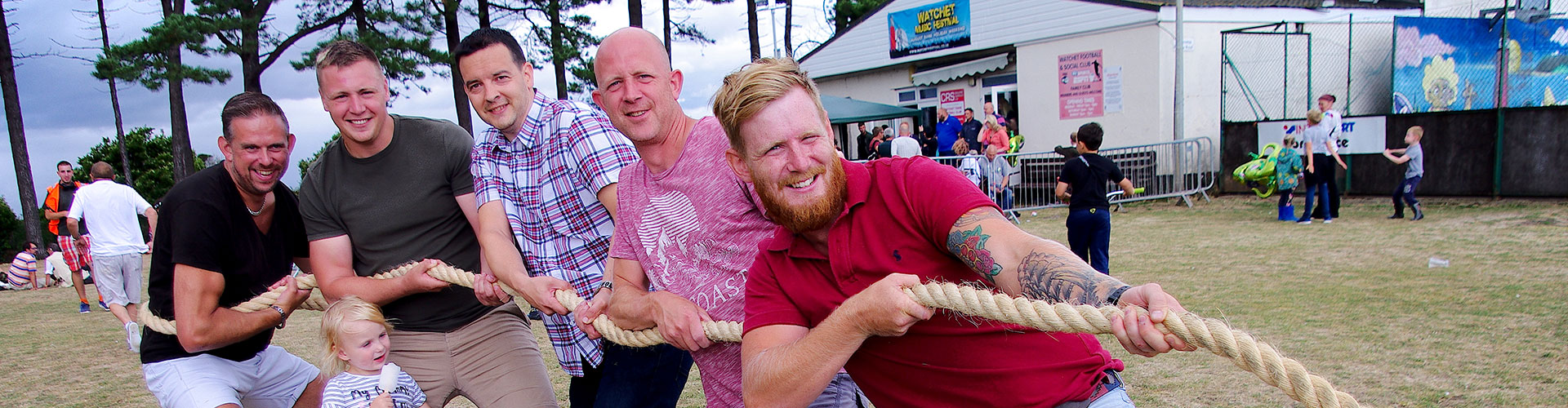 Watchet locals playing tug of war and smiling